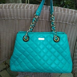 Quilted bag with chain handles